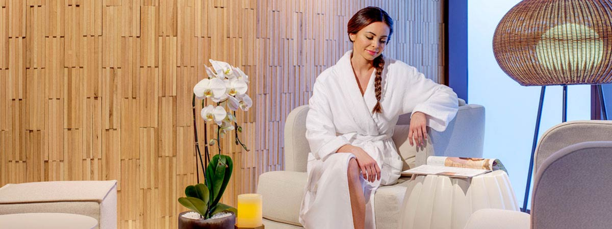 Sitting in spa with robe